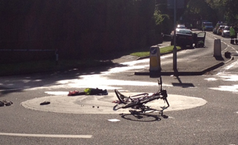 COLLISION - the mangled bike and the clothes the woman had to be cut out of