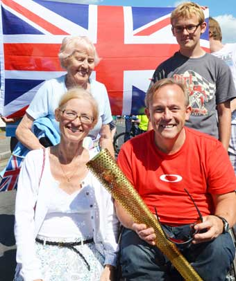 DABB HAND – Chris Dabbs shows off his Olympic Torch with wife Helen, son George and mum Brenda