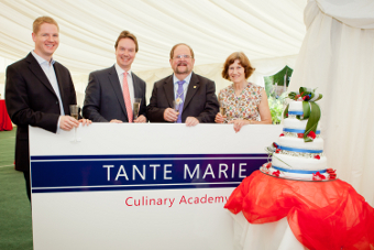 RAISING A GLASS – Principal Andrew Maxwell and MP Jonathan Lord with Deputy Mayor and Mayoress Derek and Rosemary McCrum