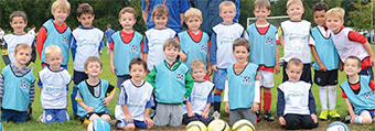 GET A KICK OUT OF IT ALL – children have been playing the beautiful game while the older generation have been exercising their vocal chords