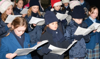 SINGING FROM THE SAME HYMN SHEET - Coworth Flexlands Independent Preparatory School choir led this year's festival carol singing at the church