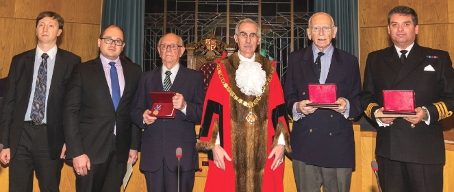 MEDALS OF HONOUR – Sergey Fedichkin and Sergey Nalobin (from the Russian Embassy), Reginald Guy, the Woking Mayor  Tony Branagan; Douglas Potts; and Commander Graham Turnbull (accepting the Ushaskov medal on behalf of Edward Tann)