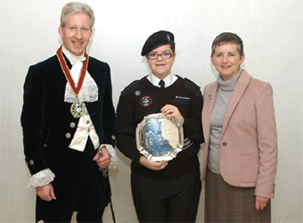 REWARDING – Mary Crawley accepts her award from High Sheriff, Peter Lee, and Denise Clarke
