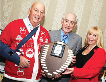 SHIELD OF HONOUR – Chobham Business Club's Gordon Parris and Tricia Matthews present the award to honourary member Peter Coxhead (Pic by Marilyn Taylor)