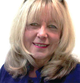 DESERVING – Surrey County Council's Eleanor Paterson is awarded the MBE for her quarter of a century's tireless work in youth support