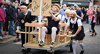 TOP OF THE CLASS – it was role reversal as these gents donned school skirts for the 2014 Pram Race