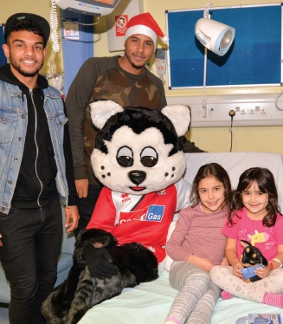 DOUBLE ACT – the smiles of players were infectious around the hospitals' wards