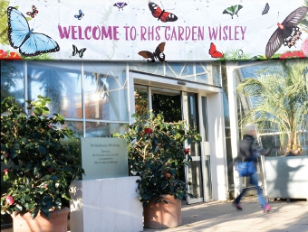 A WARM WELCOME FROM WISLEY– The Glasshouse entrance announces the butterfly display