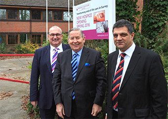 MAKING A HOUSE A HOME – Council Leader John Kingsbury and Councillor Saj Hussain outside the new home of Woking Hospice in Goldsworth Park (Picture by: Tony Charters)