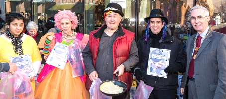 COSTUME CAPERS – the team from the Woking Community Project were hailed the day's best-dressed entrants, and picked up a prize from the Mayor