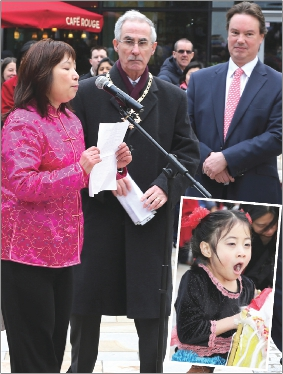 OFFICIAL INTRO – Michelle Wong takes the mic while Mayor Branagan and MP Jonathan Lord look on and a wee girl suggests it's bedtime