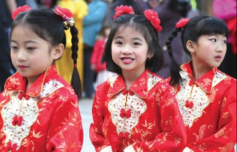 TOO CUTE – these young ladies donned traditional detailed garb of high colour