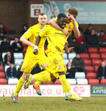 HARRIER JUMP NET – Yemi Odubade is mobbed by Joey Jones and Mark Ricketts after his leveller at Kidderminster (Picture by: Garry Griffiths)
