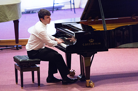 FULL-SCALE PERFORMANCE – one of the finalists, James Carrabino, plays piano