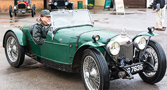 MOTORING MAN – many car enthusiasts were completely unfazed by the deluge and carried on regardless