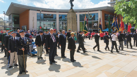 UNITED FRONT – the poignant service in Woking's glorious Jubilee Square (Pictures by Tony Charters)