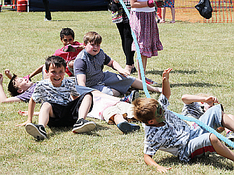DOWN TO EARTH – laughing after the final tug in the kids' edition of the tug of war contest