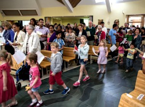 ON THE MOVE – the congregation's youngest members were very much a part of the party