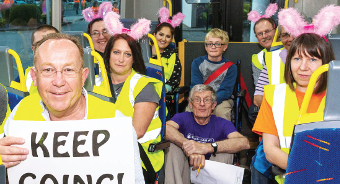 INVALUABLE HELP AND SUPPORT– volunteer marshals await to be bussed to their respective stations