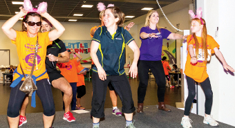 A FAR STRETCH – Iona Campbell from Nuffield Health leads the warm-up before the main event