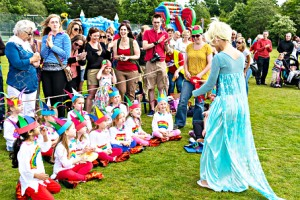 JEST PERFECT – judge Frozen's Elsa (Sophie Hitchcock) hands the Best Dressed Group award to the 1st West End Rainbows