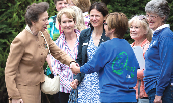 HOW DO YOU DO? – shortly after her arrival HRH meets Chairman of Surrey County Council, Sally Marks; the county's High Sherrif, Elizabeth Kennedy; and Joanne Potter, who is Mayor of Surrey Heath