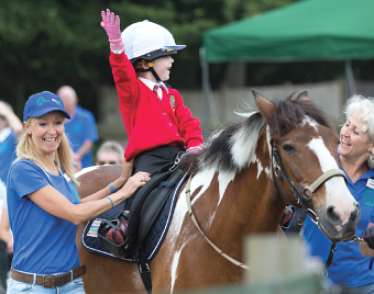 SALUTE THE CROWD – this young rider had a whale of a time