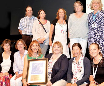 INTERNATIONAL RECOGNITION – Maggie Pringle (front, third from left) and the Surrey Health Visiting Team with their award and Deputy Programme Director Carmel Duffy (back right)