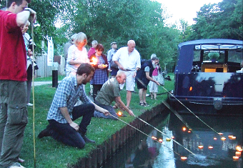 POIGNANT MOMENT – Woking Action for Peace launch their tealights flotilla on the River Wey