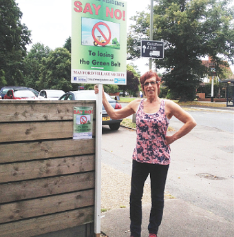 SIGN OF THE TIMES – Jackie Curry with her placard on Egley Road